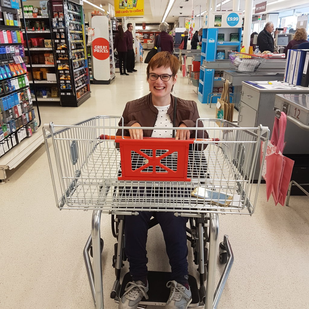 Me with a shopping trolley attached to my chair